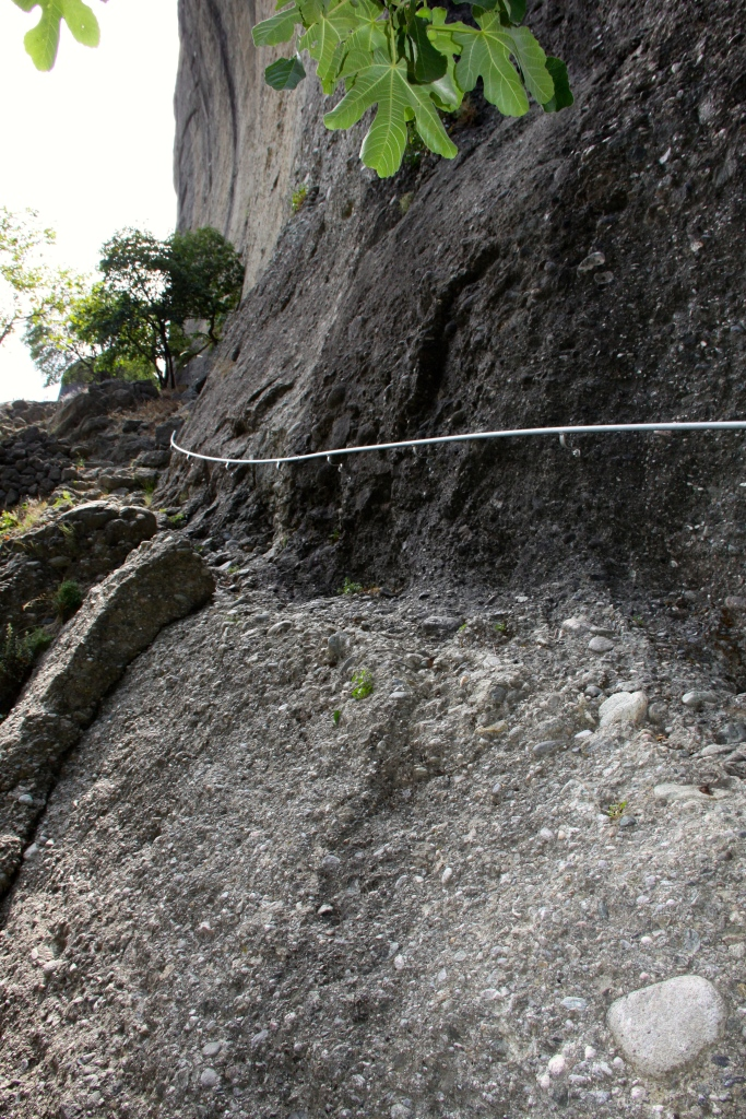 The rocky ledge gets a bit narrow here, so they've installed a handrail