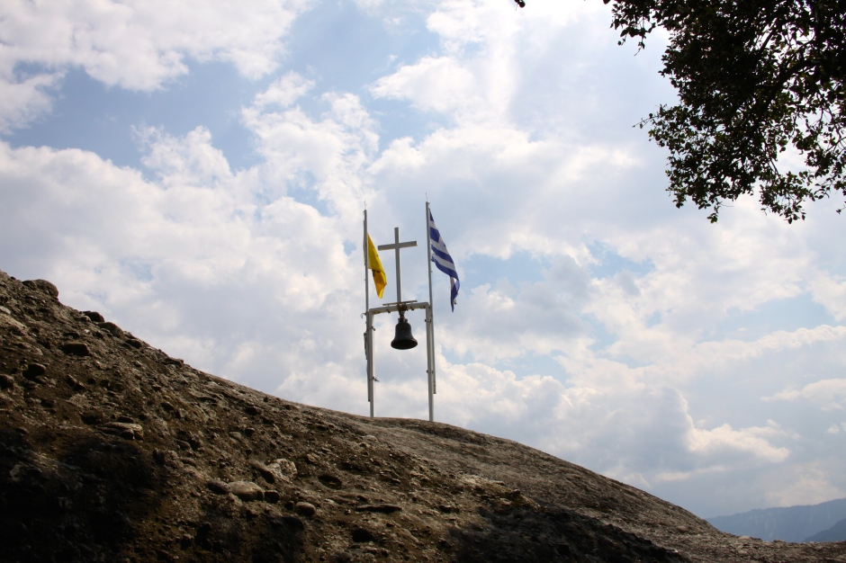 The bell, flags and cross at the top of the ridge