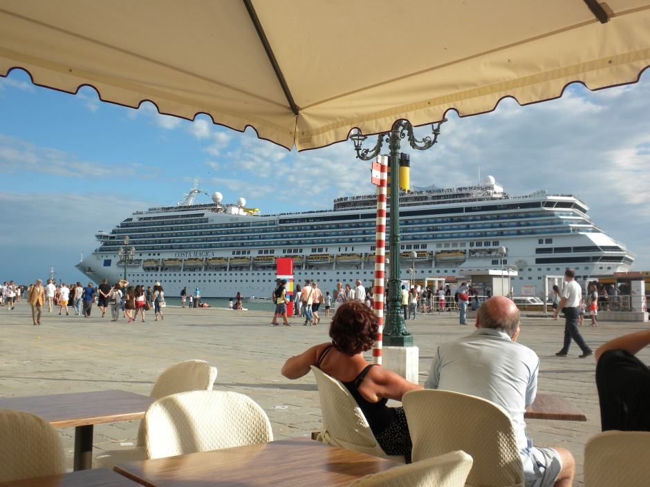 The Costa Magica (sister ship to Costa Concordia) leaves port as I watch from the restaurant