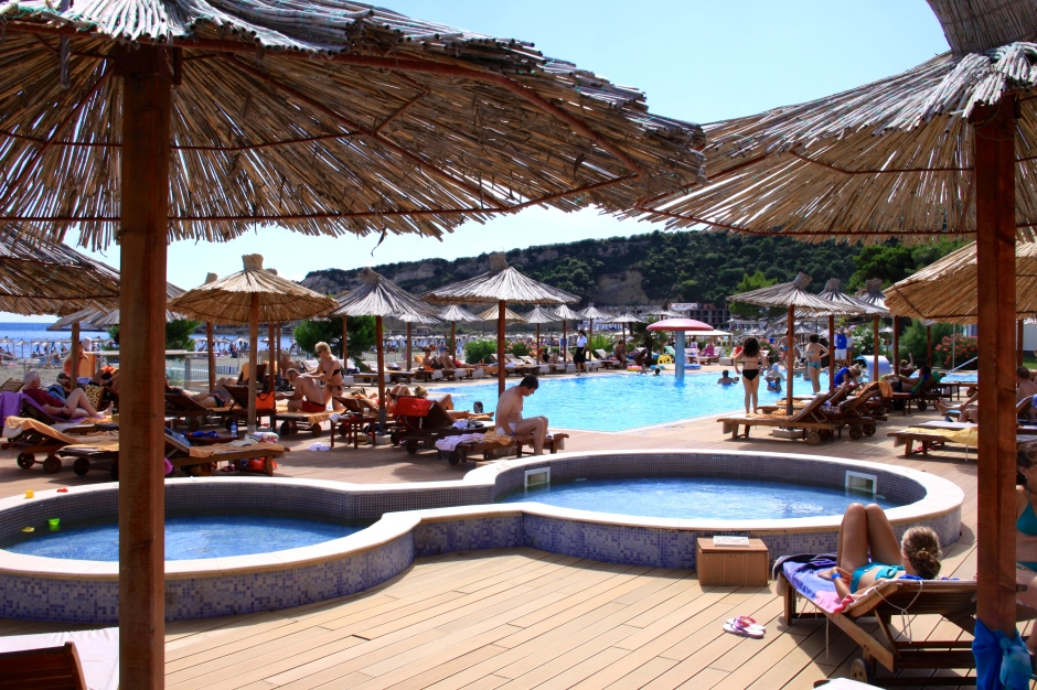 A hotel pool situated next to the beach