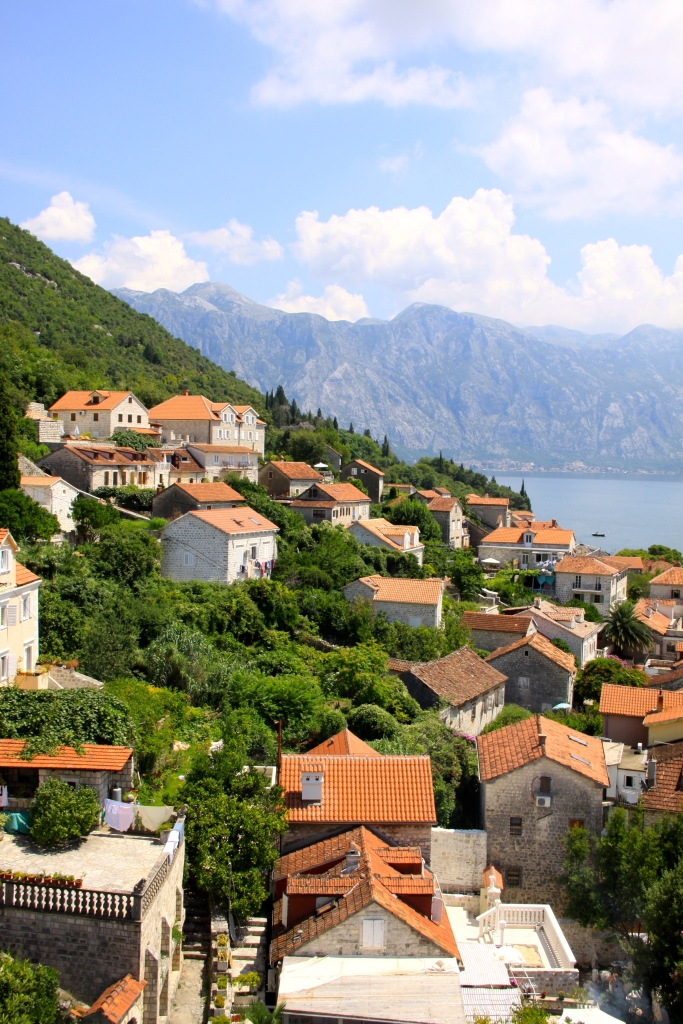The houses in Perast climb the hillside along the Bay of Kotor