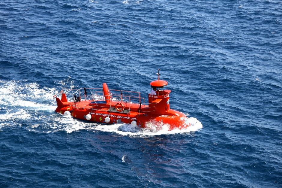 A semi-submersible tour boat passes by
