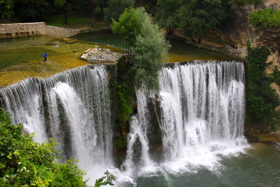 The guy standing at the top of the falls gives an idea of the height of them (22 metres)