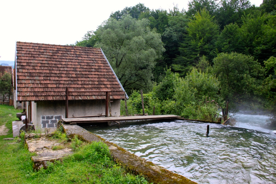 Mill building with reservoir of diverted river water