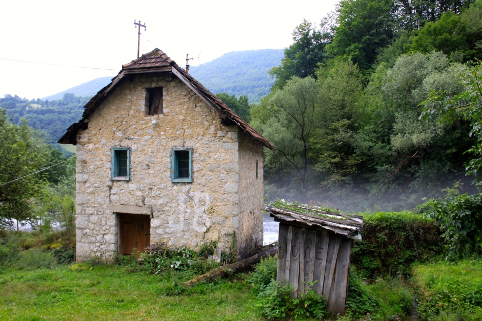 Old stone building next to the river