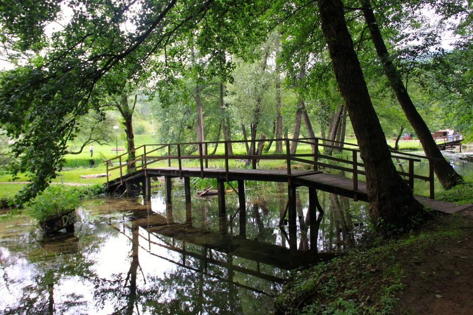 A footbridge below the mills