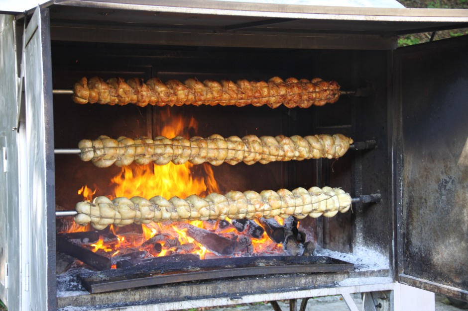 Whole chickens turning on the spit