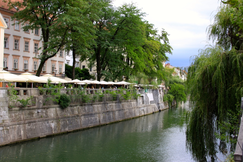 Ljubljanica River with riverside cafes on the opposite bank