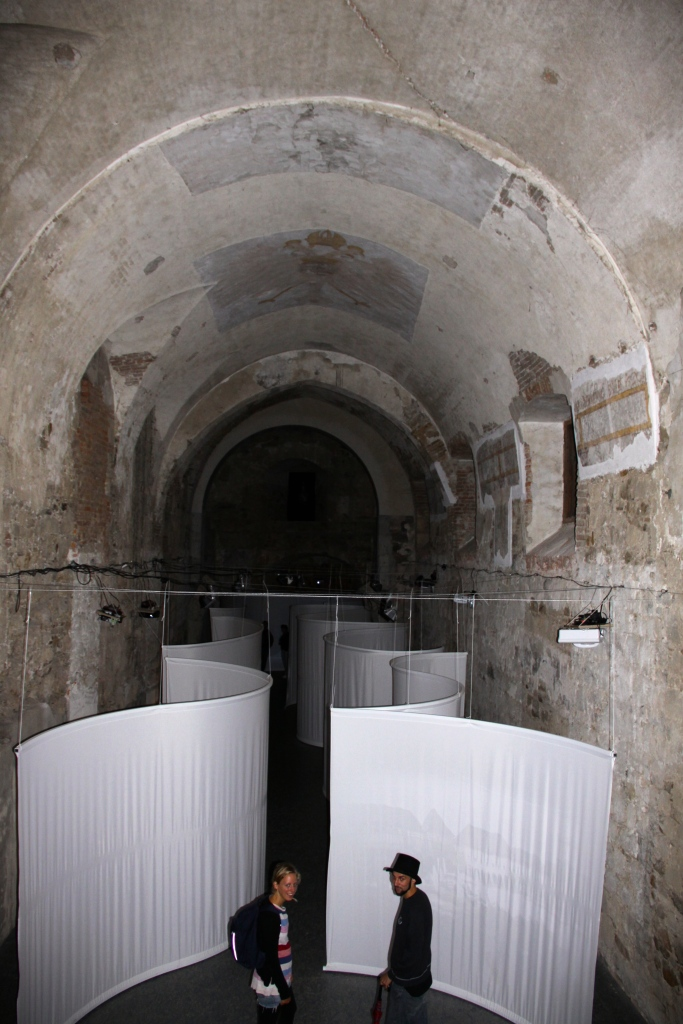 Historical images are projected onto curving screen in the casemates section of the castle