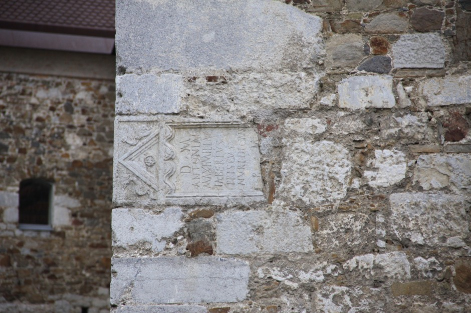 When the Archers Tower was built, they recycled masonry that they found on the site. In the photo you can see an old Roman tombstone used in the construction.