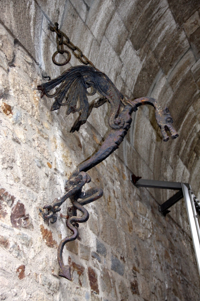 A dragon figure hanging from the wall in the main entrance gate