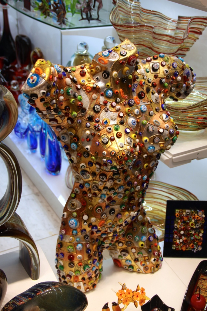 A mannequin decorated with Murano glass beads