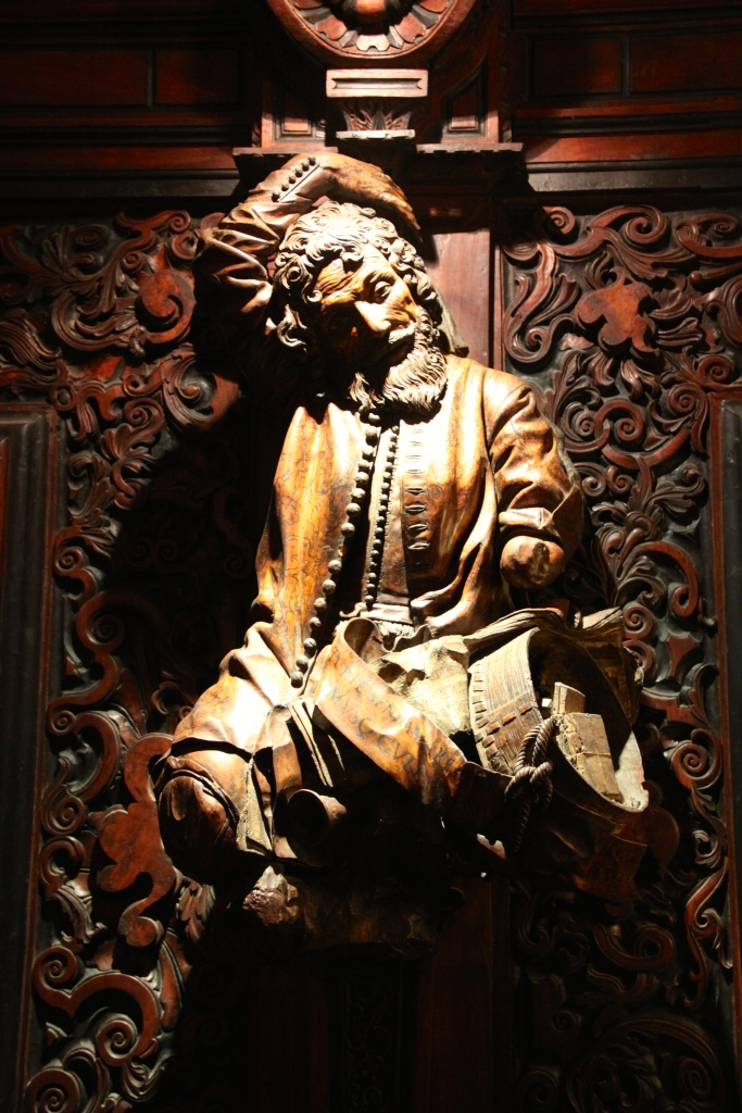 One of the many wooden sculptures that adorn the walls around the second floor