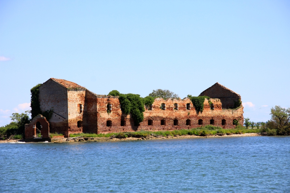 This large derelict building occupies its own island in the middle of the lagoon