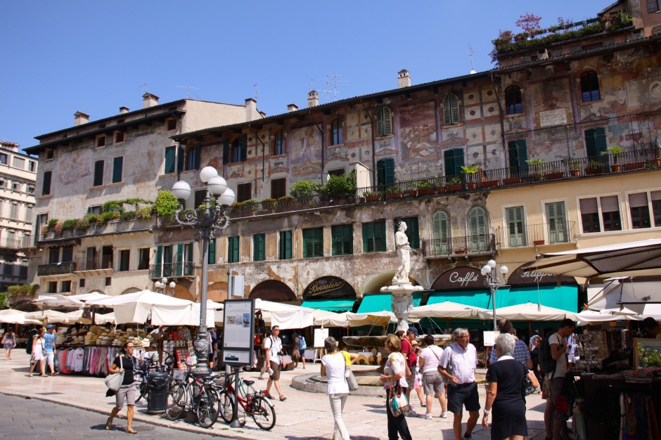 The frescoed Mazzanti Houses are behind the market.