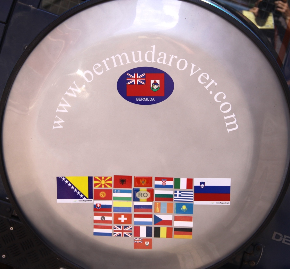 The spare wheel cover of the Defender, showing the flags of the countries visited.