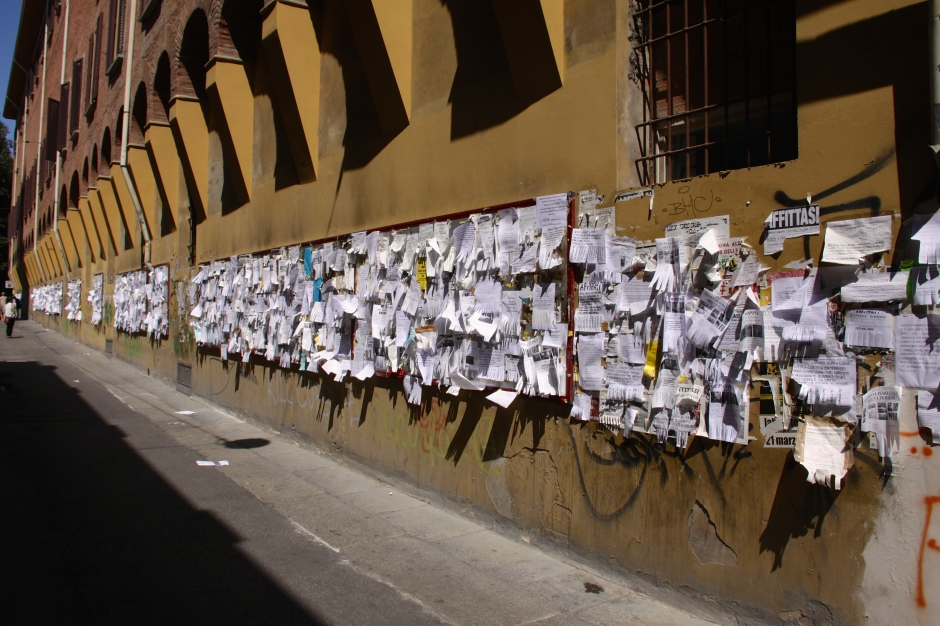 'Old school' version of e-bay: a whole wall full of advertisement posters in Bologna