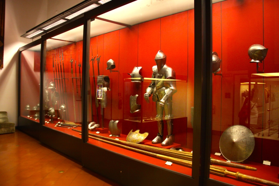 There is a collection of medieval armoury and weaponry