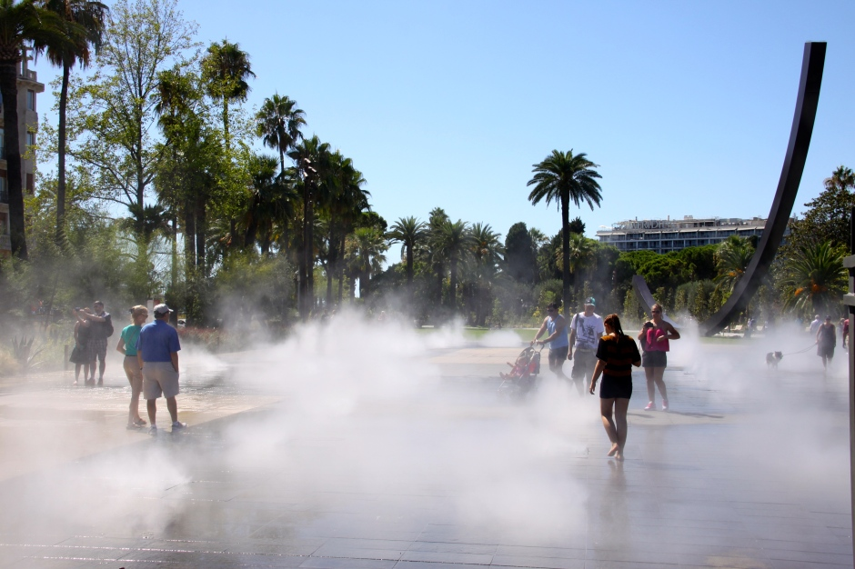 A cooling off section of a pedestrianised area, where a cooling mist of water sprays from the ground