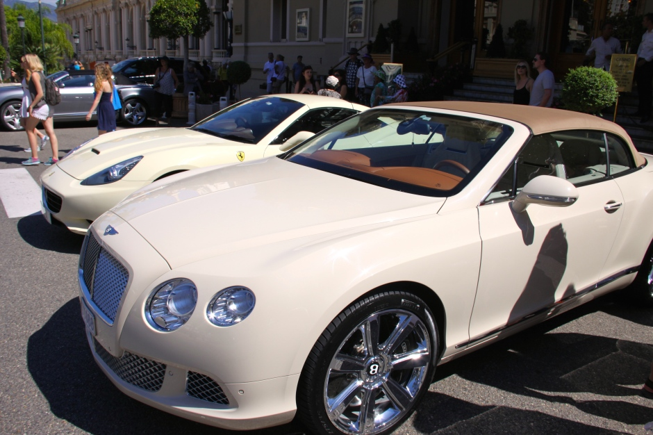A Bentley convertible and a Ferrari outside the casino (and a silver Bentley in the background)