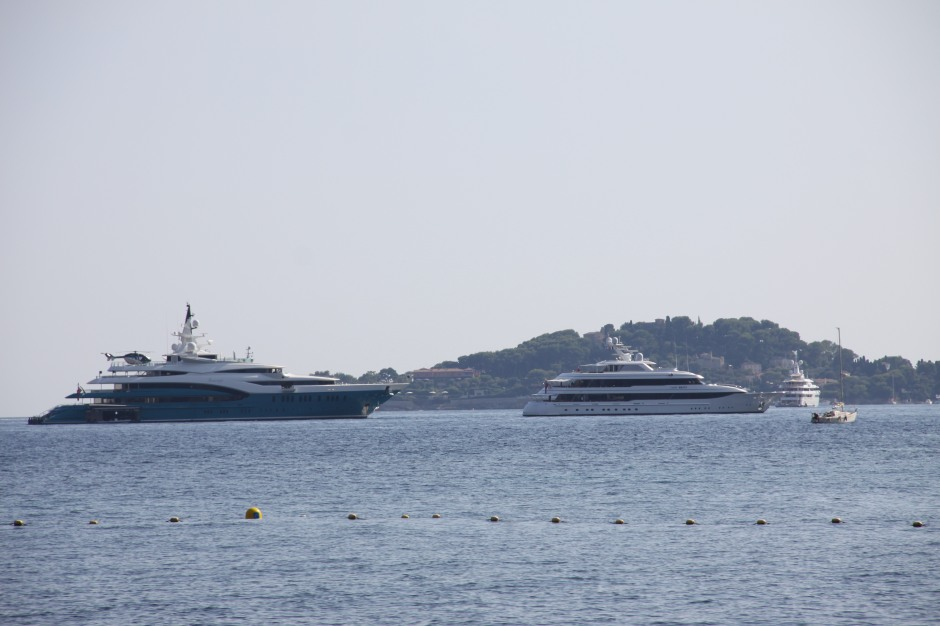 A couple of super yachts at anchor in the bay