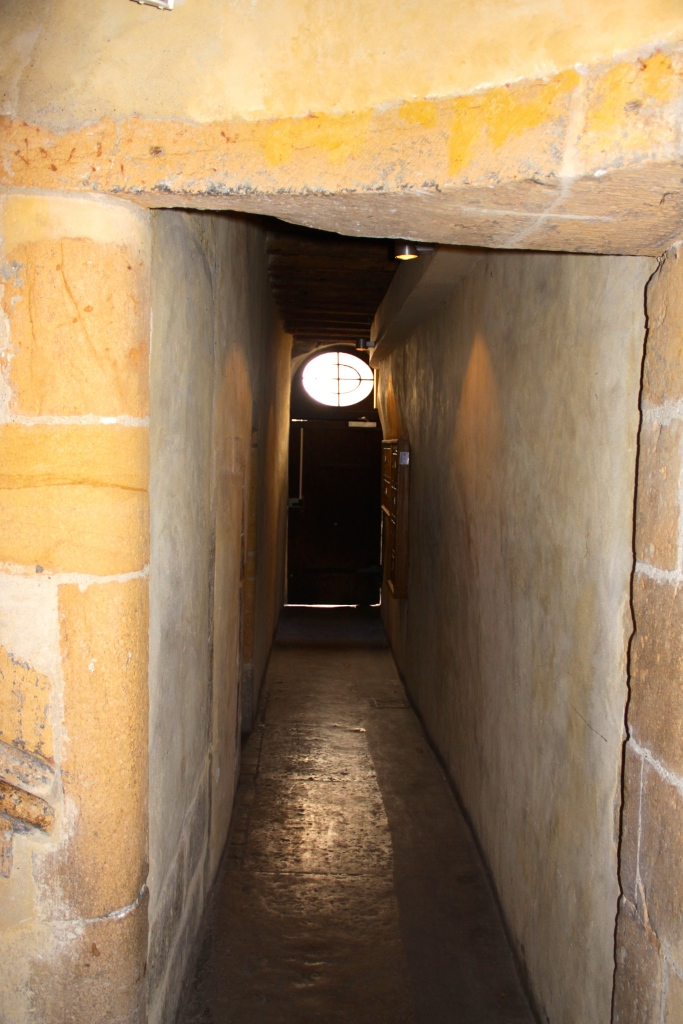 Traboule passageway leads to an exit door