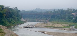 Disused bamboo bridge and permanent cycle and motorcycle bridge