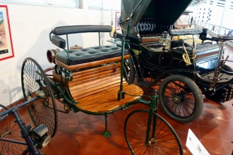 Reprioduction 1886 Benz (first car with internal combustion engine)