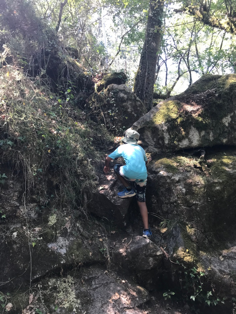 Ethan enjoying climbing over rocks